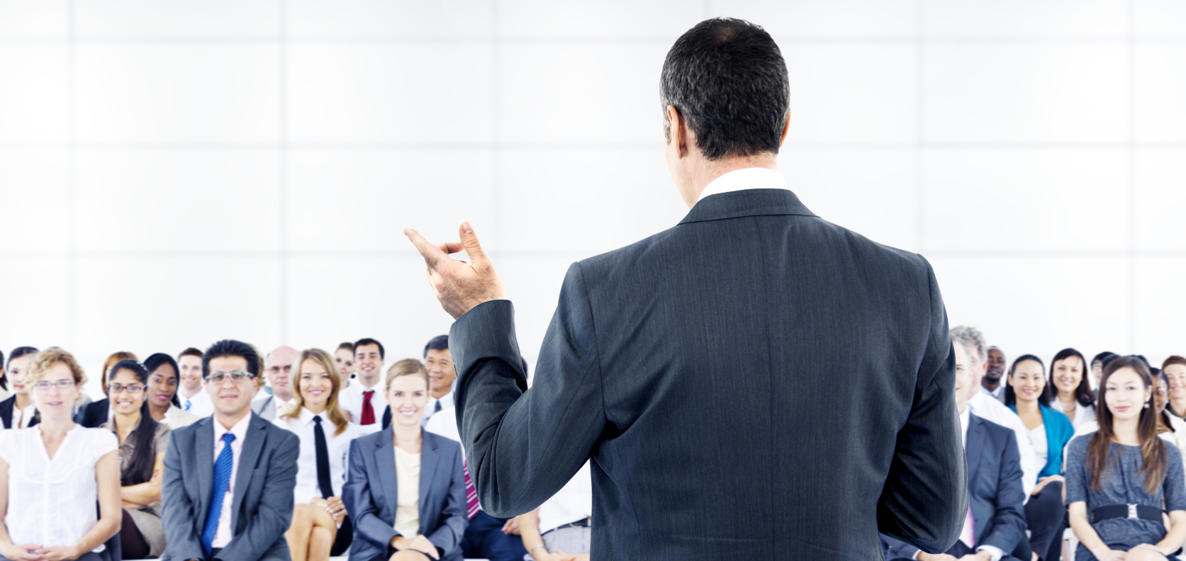 Man giving speech to large audience