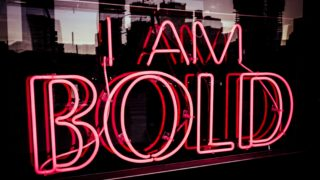 "A neon sign that says, ""I am bold."""
