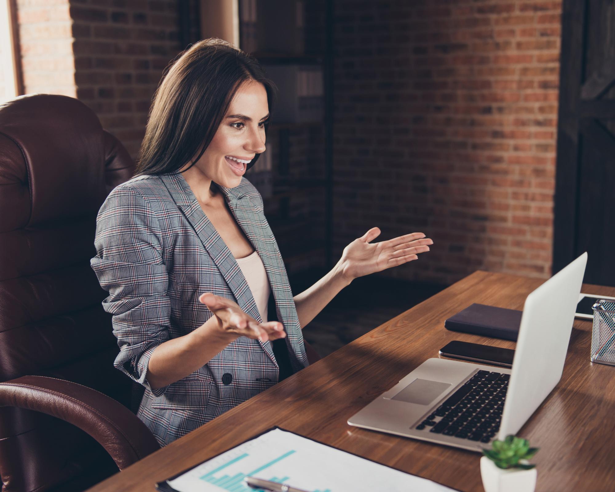 Business woman talking in virtual meeting working on presentation skills basics.