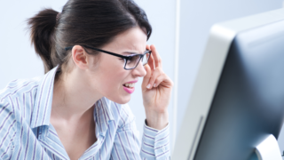 Woman squints at screen - PowerPoint presentation tips
